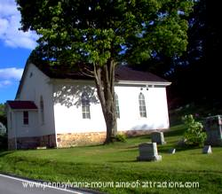 photo of the little white church home to bat colonly at Canoe Creek State Park