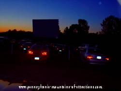 ghostly energy orbs floating through Carroltown drive-in theater