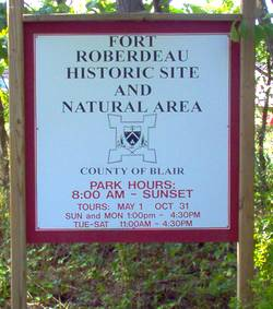 photo of a sign at Central Pennsylvania historic landmark Fort Roberdeau telling the times and opening and closing dates