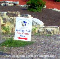 Artison Trail sign in front of Jean Bonnet Tavern