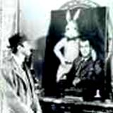 A photo of a man looking at a portrait of Jimmy Stewart and his pooka, Harvey