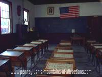 photo of a one room schoolhouse classroom at Old Bedford Village