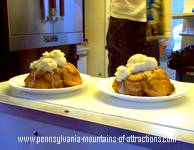 a photo of hot monkey bread with ice cream