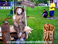 Chainsaw carving saying Sweet Cider 1 cent, Hard Cider 5 cents
